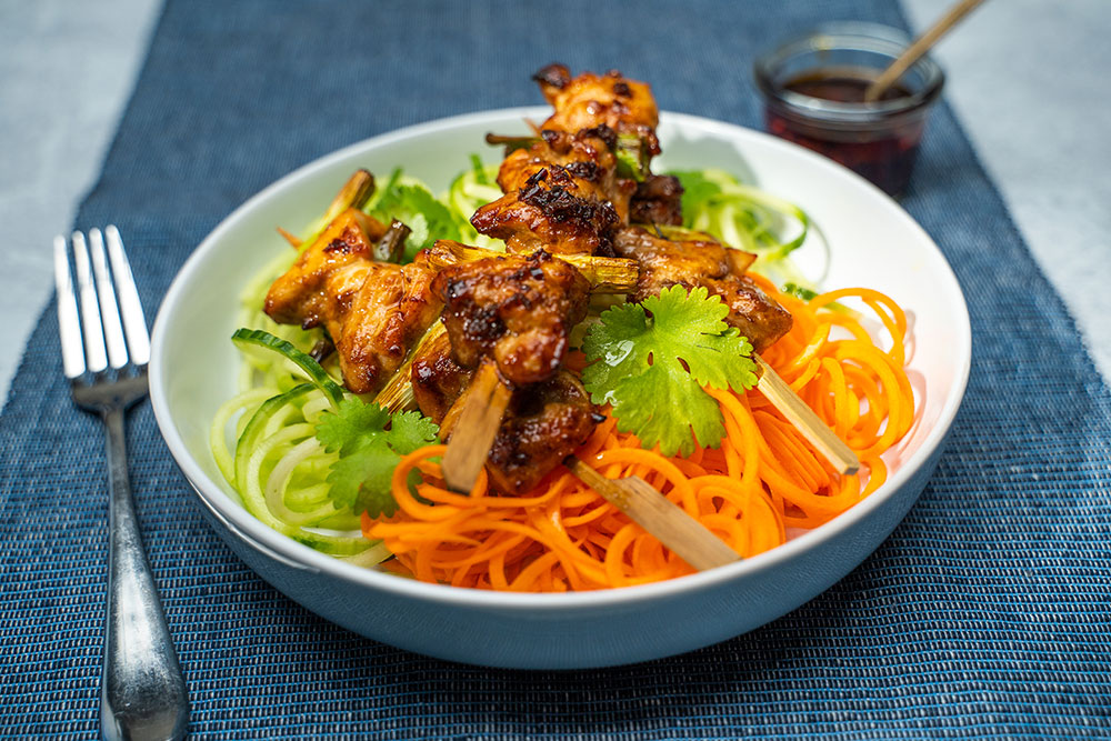 Chicken yakitori on spiralised cucumber and carrot salad with Lee Kum Kee marinade