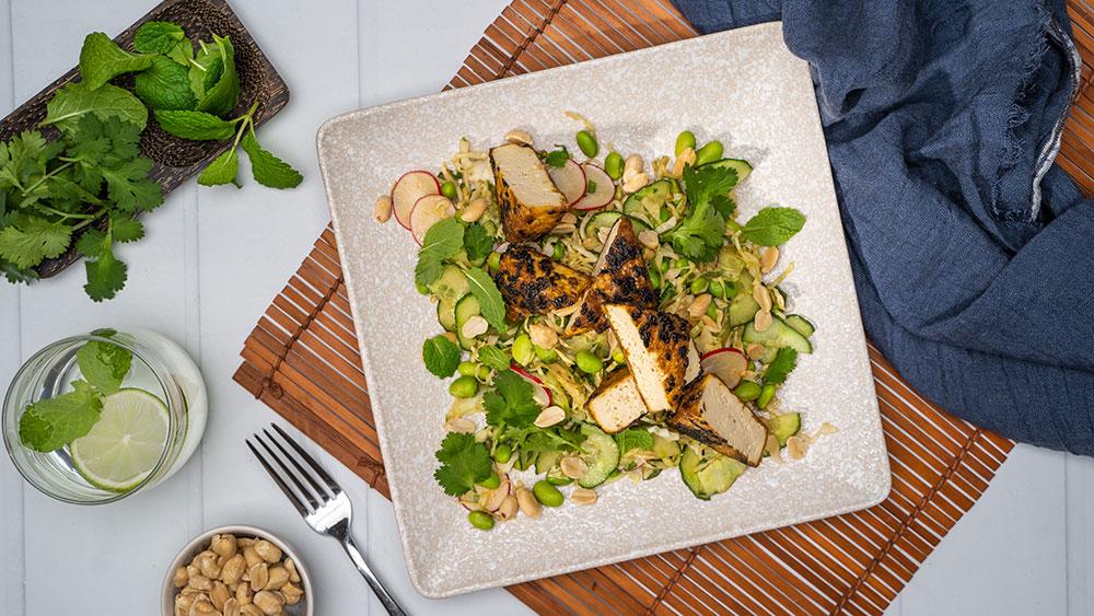 Crispy tofu on cucumber, raddish, peanuts and herbs salad with Lee Kum Kee marinade