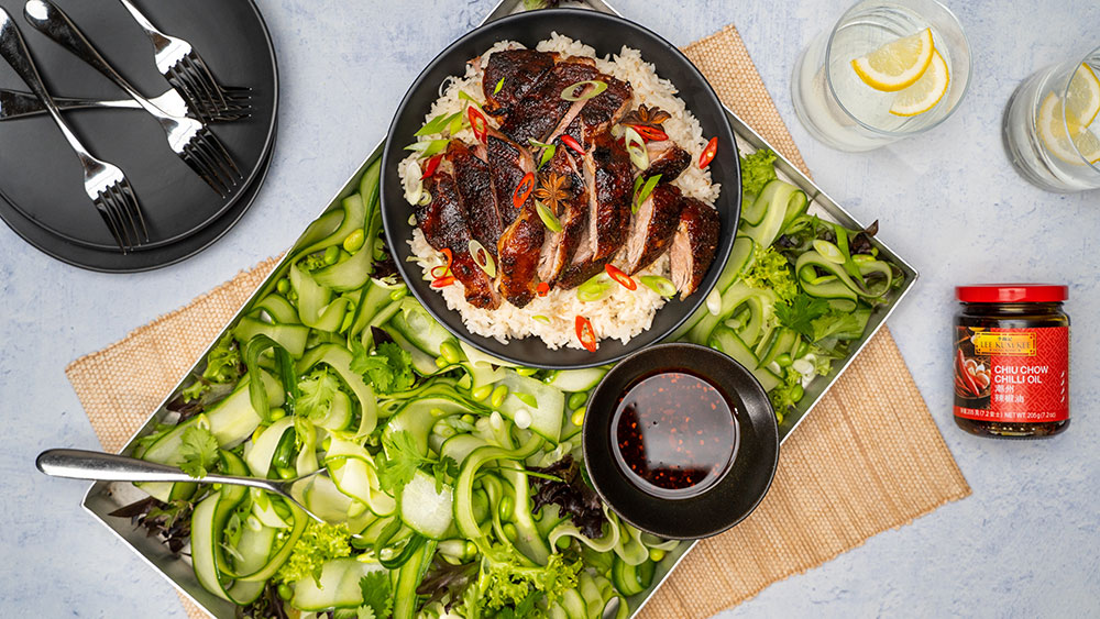Sticky duck on rice with a cucumber salad and Lee Kum Kee chilli oil jar